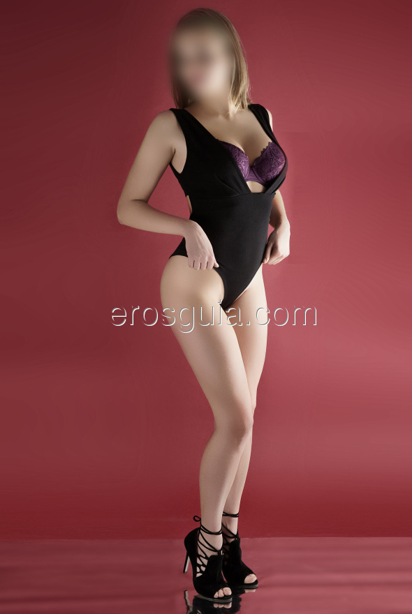 She's tall, white, slim, blonde and with a youthful look, with beautiful...